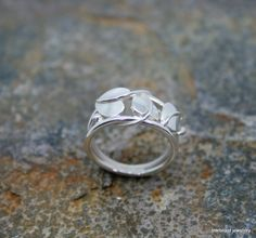 A completely handmade and original art nouveau styled leaf ring. All leaves have been saw pierced from sheet silver and formed to shape with soldered veins and mounted on a double, round wire mount.  #artnouveau #leaf #ring #silver #jewellery #cornwall #uk #gb #westcountry #devon #england #silversmith #pretty #jeweller #jewellers #handmadejewellery #handmade
