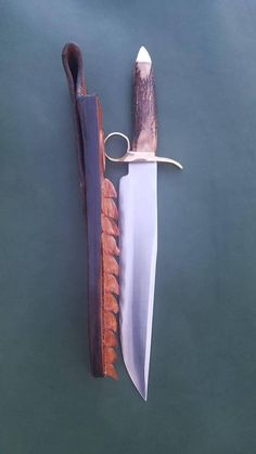 Tombstone bowie knife and custom croc sheath.