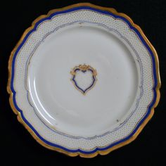 Simplicity graced the 1853 White House china of First Lady Jane and President Franklin Pierce, 14th President of the United States (1853-1857). Imported and decorated by Haughwout and Dailey, New York with golden blue rim lines and border stippled with gold dots. At center is an empty blue and gold escutcheon. There were only 287 pieces in the total order.