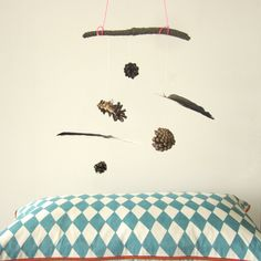 Oliver would LOVE to make one of these with his feather and pine cone collection!