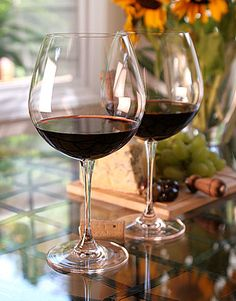 Since I'll need new wine glasses after we move because I've already broke a couple! Oops!!  Robert Mondavi by Waterford Pinot Noir Glasses, Pair