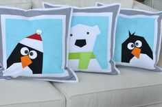 Adorable paper pieced penguin and polar bear pillows.