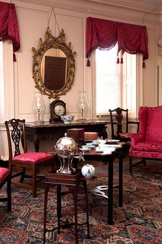 In many sophisticated Charleston houses the main drawing room was located on the second floor, above the dirt and the noise of the street. The ornamented chimneypiece is an important statement of American Rococo design and execution.