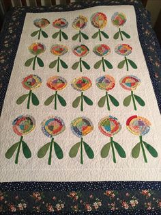 Rag blossom quilt, stipple quilted.  Quilt by Penny Anderson.