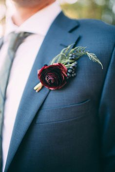Groom in a Navy Suit with a Burgundy Boutonniere