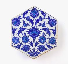 Tile | Origin: Iznik, Turkey | Period: ca. 1525-50 Ottoman period | Details: During the early sixteenth century, Iznik ceramic production focused primarily on vessels. With the accession of the Ottoman ruler Sultan Sulayman (reigned 1522–60), and his ambitious building projects throughout the empire, demand for Iznik tiles grew and rivaled that for ceramic objects. The elegant design of this blue-and-white tile, combining full lotus flowers, broken stems, and serrated leaves, finds many ...