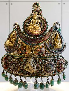 Ceremonial crown of the type worn by royal princes in Nepal. Ca. 1850-1890. Silver, gold and stones. Height: 25.4 cm (10 in). British Museum