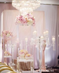 These tall transparent pillars filled with fairy lights and topped with blush blooms transformed the aisle at this #Vancouver #wedding into a glittering, pastel walkway! | Photography By: Hong Photography | WedLuxe Magazine | #luxury #wedding #luxurywedding #weddinginspiration #floral #floralarrangement #decor #flowers #decor #decordesign #event #ceremony