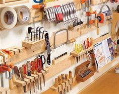 Woodworking Shop Hyperorganize Your Shop - Popular Woodworking Magazine - Hyperorganize Your Shop A hook-and-slat wall system puts everything at your fingertips. By Jock Holmen I've struggled with the clutter in my small garage shop for years. Workshop Storage, Workshop Organization, Garage Workshop, Garage Organization, Tool Storage, Garage Storage, Organization Ideas, Storage Ideas, Lumber Storage