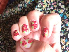 As spring has sprung, I tried my first attempt at some pretty red rose nails.