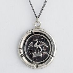 Loving my talisman by Pyrrha. Dragon in Crown Wax Seal Necklace symbolizing power and protection