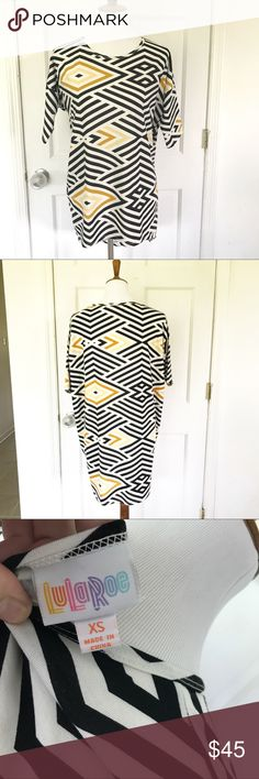 NWOT Lularoe Irma black/yellow/gold size XS. Lularoe Irma new without tags. Black, yellow, and gold geometric pattern. Tunic with longer back. Perfect with leggings or jeans. Reasonable offers welcome. LuLaRoe Tops Tunics