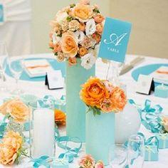 最新のコーディネート 『CANDY COLORS COLLECTION』 マーメードブルー&アプリコットオレンジ テーブルのお花もテーマカラーに合わせてプロのデザイナーがコーディネートをご提案可愛く・オシャレにパーティーを楽しめちゃう! 博多サンヒルズホテルの披露宴会場の写真詳細【13】