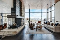 Stunning space with wooden ceilings, exposed fireplace, floor to ceiling windows, exposed brick walls and contemporary furniture | Pearson Design Group