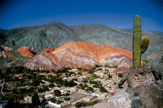 """Cerro de los Siete Colores or """"The Hill of Seven Colors"""" is one of the hills bordering the tiny village of Purmamarca, in Jujuy Province, in north-western Argentina. San Salvador, Argentina Culture, Parvis, Visit Argentina, Colorful Mountains, Hotels, Holiday Destinations, Amazing Nature, Where To Go"""