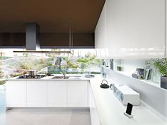 Fitted kitchen with peninsula ORANGE by Snaidero