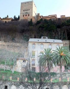 Granada - View of an Alhambra tower and a carmen  on the Alhambra hill      photo R.Bovington blog post: http://bovingtonphotosofspain.blogspot.com.es/2012/02/granada.html