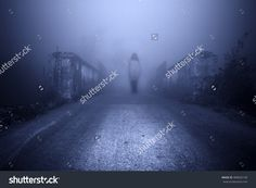 Haunted Female Ghost At The Road In The Middle Of The Misty Night. Stock Photo 489605158 : Shutterstock
