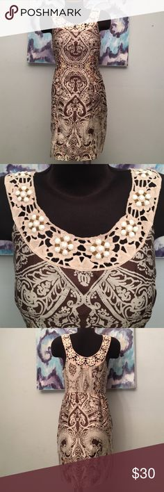 Free People Dress Beautiful design. Zips up on the left side. Lined. Crochet and beaded neckline. Excellent condition. 100% Cotton. Free People Dresses