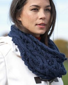 Bundle up in this elegant cable cowl for a stylish take on winter wear. Shown in Bernat Satin Sparkle..