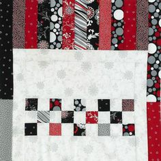 Create  an extra-long table runner using the Carnival collection from Red Rooster  Fabrics. The light background provides room for quilting experimentation:  Try a light-color thread for a subtle look or, for more pizzazz, use a  black-and-red variegated thread.