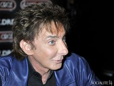 June 23rd, 2011-Barry Manilow made a personal appearance at Dress Circle in London, England to promote and sign copies of his new album, ' 15 Minutes. Description from socialitelife.com. I searched for this on bing.com/images