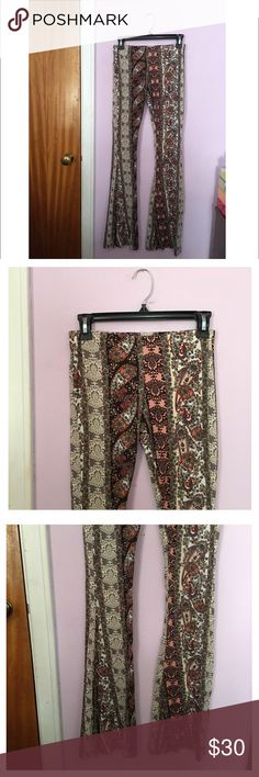Floral Boho Pants Amazingly super soft boho flare pants featuring a lovely floral & paisley pattern! These are so flattering & look amazing with a flowy top or a simple crop top & sandals.  A definite staple for every summer wardrobe.  - Size S. - Super stretchy waistband. - Fit & flare style. - NWOT, never worn. Boutique Pants Boot Cut & Flare