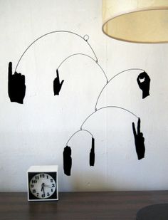 "Shadow mobile of ""I love you"" in sign language."