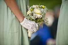 dusty millers. green bridesmaids and gloves