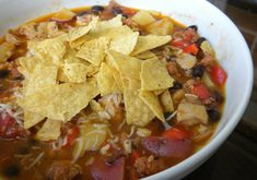 Rachel Ray's Chorizo, Chicken and Tortilla Soup...my new go to 'taco soup' recipe. Try it topped with cilantro, scallions, cheese and sour cream.