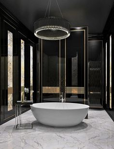 Check out this #bathroom and the sleek black and gold theme. http://www.remodelworks.com