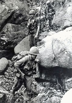 "The forward observer of Charlie Company, 4th Bn 12th Inf, 199th Light Infantry Brigade, 1LT Joseph T.  Turner leads the way through rocky ground in the jungles 30 miles northeast of Xuan Loc.  The Charlie company ""Warriors"" were on a sweep operation of the area, which contained many enemy bunkers.  April 70 photo by SP4 R. Seitz, 199th Inf Bde PIO."