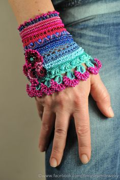 This colorful cuff is made from high quality cotton thread with resistant colors. The main colors are cyclamen, denim and mint. It is decorated