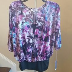 Colorful JLO Top A delicate, flowy and beautiful overlapped sheer top. It looks like a two piece, but the hem holds the tank top and the shell as one piece. The hem is stretchy and the cuffs close down with elasctic. It would fit any body type. Jennifer Lopez Tops