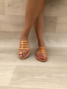 A pair of Greek Leather Sandals that is made from genuine leather in natural color in Greece. Toe Ring Sandals, Strappy Sandals, Flat Sandals, Leather Sandals, Women Sandals, Shoes Women, Ladies Shoes, Flats, Greek Sandals