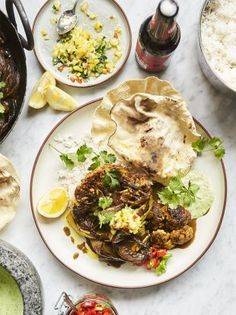 Gnarly grilled cauliflower, rogan josh curry paste, perfect fluffy basmati rice, fresh coriander, red chilli flakes and cool natural yoghurt. A beautiful vegetarian curry recipe from Jamie Oliver.