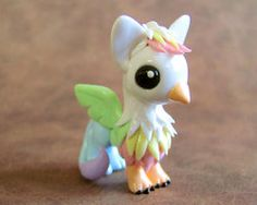 Pastel Rainbow Gryphon by *DragonsAndBeasties on deviantART