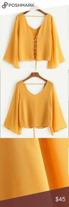 The TRACEY Laced Up Flutter Top Spring into Fall with this gorgeous laced up top. Features a bell sleeve which gives it a nice flutter style. Can be easily worn up or down. One size fit most. Will fit extra small - medium. Possily large since the top may br adjusted. Tops