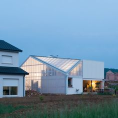 """Asymmetric French house designed by GENS as a collage of """"banal components"""""""