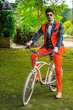 Orange and blue cotton-satin patchwork suit with notch lapel with 2 buttons closure. Flap pockets and straight buttonholes. Twin vents at back, style 1029 Ottavio Nuccio Gala, 2015 Fashion Collection.