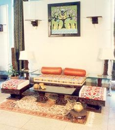 Simple Indian platform chairs and sofa.