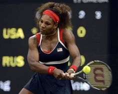 USA's Serena Williams hits the ball in a game against Russia's Vera Zvonareva during a tennis match at Wimbledon's Centre Court at the London 2012 Olympics on Wednesday, August 1, 2012 in London.