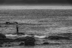 A lone fisherman stands on a rock as the waves crash around him. Fishing is a way of life in Galicia and the light, the weather and the ruggedness of the landscape often make for visual poetry.