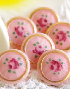Sweet vintage, pink glass buttons with rose design.