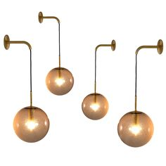 Large Set of 24 1960s Wall Light with Brass Details | From a unique collection of antique and modern wall lights and sconces at https://www.1stdibs.com/furniture/lighting/sconces-wall-lights/
