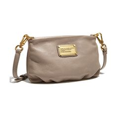 Rich, lightly textured leather fashions a gently gathered crossbody bag finished with a gleaming metal logo plate.