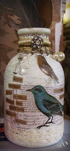 Last week i began work on these Christmas Clearance bottles that i got for 99 cents. this one got 2 coats of gesso, two coats of silver pai...