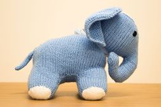 A side profile picture of a cute knitted elephant.