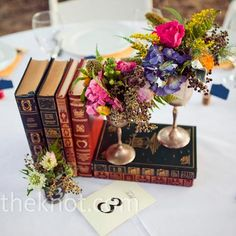 Real Weddings - A Vintage Wedding in Normangee, TX - Vintage Book Centerpieces (simple centerpieces wedding) Vintage Book Centerpiece, Book Centerpieces, Vintage Wedding Centerpieces, Floral Centerpieces, Wedding Decorations, Wedding Vintage, Centerpiece Ideas, Vintage Table Decorations, Book Centrepiece Wedding
