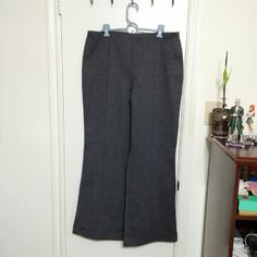 Dress pants Sleek grey dress pants. Great for work or interviews. Material is heavy (about the weight of a pair of well-made jeans) but super comfortable due to its smooth texture and slight stretch. No pockets.  Material: 5% spandex 25% rayon 70% polyester Cato Pants
